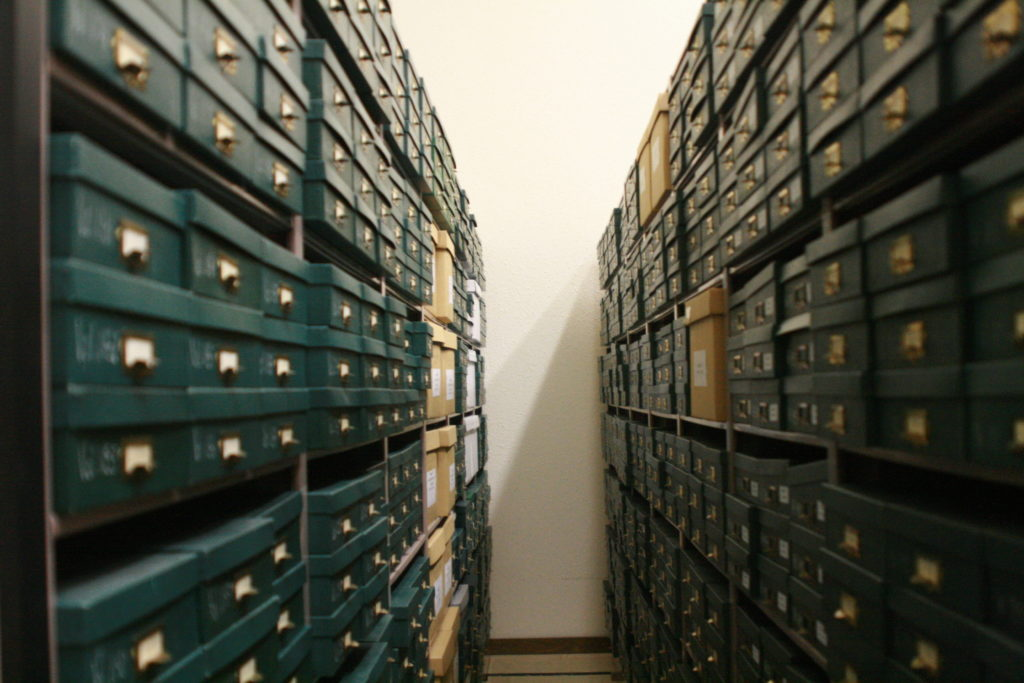 Stacks of denominational records within the vault at the Mennonite Heritage Archives.