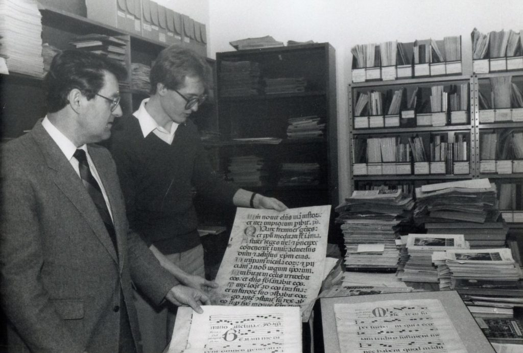 Lawrence Klippenstein (left) and Jim Suderman looking at manuscripts in the Mennonite Heritage Center archives.