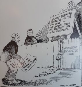 """Political Cartoon from the 1920s. At Saskatchewan Immigration gate a sign reads """"No More European settlers for the present, the English speaking residents are to be considered."""" A mennonite who is banned from entering holds a paper that reads """"plan to settle 5,000 Mennonites in Saskatchewan."""""""