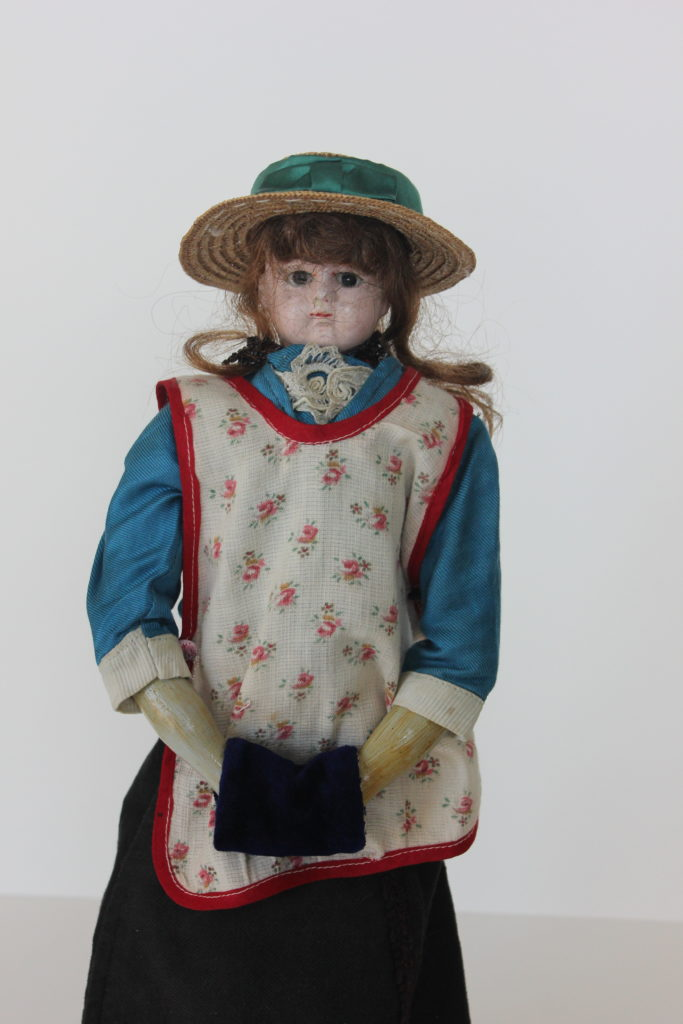 Doll with apron from Johannes Dyck's Collection